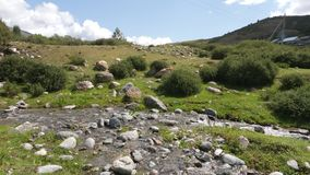 Beautiful landscape with mountain river, stones and green valley stock footage