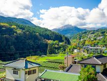 Beautiful landscape of the mountain with some rooftop houses, in a gorgeous blue sky in Japan Stock Image