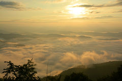 Beautiful landscape mountain view at sun rising with mist Royalty Free Stock Images