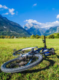 Beautiful landscape of mountains and a bike in summer Stock Images