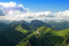 Beautiful landscape with mountains and green hills. Beautiful summer landscape with mountains and green hills Royalty Free Stock Photography