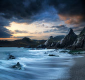 Beautiful landscape of mountains and sea at sunset Stock Image