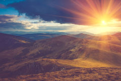 Beautiful landscape in the mountains at sunshine. Filtered image:cross processed vintage effect Royalty Free Stock Photo