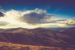 Beautiful landscape in the mountains at sunshine. Filtered image:cross processed vintage effect Stock Photo