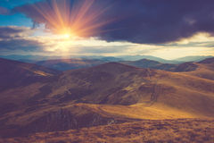 Beautiful landscape in the mountains at sunshine. Filtered image:cross processed vintage effect Royalty Free Stock Photos