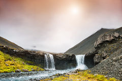 Beautiful landscape with mountains and waterfall at sunset Royalty Free Stock Photography