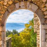 Beautiful landscape at Nafplio in Greece through the old arched stoney doorway of Palamidi castle. Stock Image