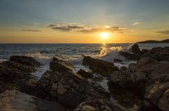 Beautiful landscape and nature photo of sunset at Adriatic Sea in Croatia Europe. Nice colorful outdoors image. Calm, peaceful picture of ocean, rocks and sky royalty free stock image