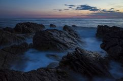 Beautiful landscape and nature photo of sunset at Adriatic Sea in Croatia Europe. Nice colorful outdoors image. Calm, peaceful picture of ocean, rocks and sky royalty free stock photography