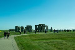 The path to Stonehenge - beautiful landscape. A beautiful landscape near Stonehenge with beautiful plantations of flowers and green grass. People walking from royalty free stock images