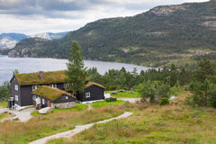 Beautiful landscape of Norway homes with green roofs and, mountainous terrain and reservoirs. Beautiful landscape of Norway homes with green roofs and Stock Photo