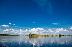Beautiful landscape with an old village near river in wild Russia. royalty free stock photography