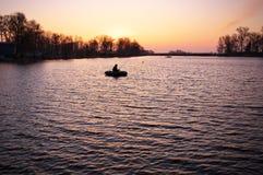 Beautiful landscape with orange sunrise, lake and fishermen Royalty Free Stock Photos