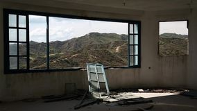 Beautiful landscape out of wide window of an abandoned hotel Stock Image