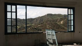 Beautiful landscape out of wide window of an abandoned hotel stock video footage