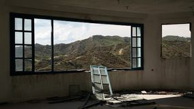 Beautiful landscape out of wide window of an abandoned hotel stock video