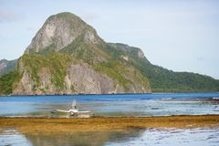 Beautiful landscape with an outrigger boat Stock Images