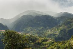 Ominous green mountains Madeira. Beautiful landscape panorama of the mountains of Madeira at Serra De Agua, on a cloudy summer day stock photo