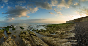 Beautiful landscape panorama sunset over rocky coastline Stock Images
