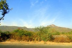 Beautiful landscape pic of Gir Mountain of Junagadh Gujarat. This picture is taken at Junagadh City in Gujarat India. The beautiful landscape of mountain is Stock Photography