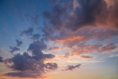 Beautiful Landscape of Pink, Purple and Yellow Clouds in Blue and Yellow Sky at Sunset Royalty Free Stock Images