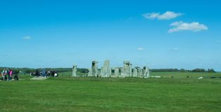 The path to Stonehenge - UNESCO World Heritage Site. A beautiful landscape with beautiful plantations of flowers and green grass. Prehistoric monument that royalty free stock photo