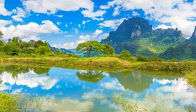 Beautiful landscape, pond on the foreground. Laos. Stock Photos