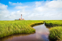 Beautiful landscape with pond and lighthouse at North Sea, Germany Stock Photography