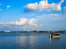 Beautiful landscape with pontoon on Lake Bemidji in Minnesota. With blue sky and fluffy clouds royalty free stock photo