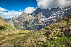 Beautiful landscape of Pyrenees mountains with famous Cirque de. Gavarnie in background Stock Photos