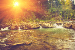 Beautiful landscape of rapids on a mountains river in sunrise. Royalty Free Stock Photos