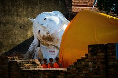 A reclining buddha in Wat Yai Chai Mongkhon in Ayutthaya, Thailand. The beautiful landscape of reclining buddha in Wat Yai Chai Mongkhon in Ayutthaya, Thailand royalty free stock photos