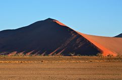 Sossusvlei, Namib Naukluft National Park, Namibia. Beautiful landscape with red dunes at sunrise, Sossusvlei, Namib Naukluft National Park, Namibia Stock Photo