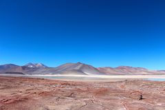 Beautiful landscape with red rocks. Clouds and blue sky   In the Atacama desert Chile Royalty Free Stock Images