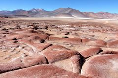 Beautiful landscape with red rocks. Clouds and blue sky   In the Atacama desert Chile Stock Image