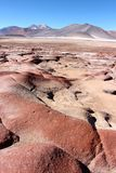 Beautiful landscape with red rocks. Clouds and blue sky   In the Atacama desert Chile Stock Photo
