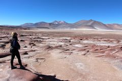 Beautiful landscape with red rocks. Clouds and blue sky   In the Atacama desert Chile Royalty Free Stock Image