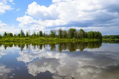 Beautiful landscape about reflection of clouds in the lake. Royalty Free Stock Photo