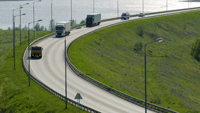 Beautiful landscape with a ride on the highway the trucks and a few cars stock video footage