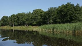 Beautiful landscape on the river bank. View from aboard the boat stock video footage