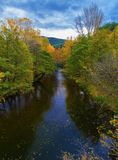 Landscape with river and colorful autumn forest stock photos