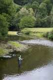 Beautiful landscape with river and fisherman Royalty Free Stock Photography