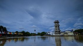 A beautiful landscape of river at north of Malaysia. The lighthouse with a background of tower Stock Photography