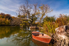 Beautiful landscape with river and red boat Royalty Free Stock Images