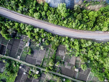 Beautiful landscape with road and settlements and plants on sides Royalty Free Stock Images