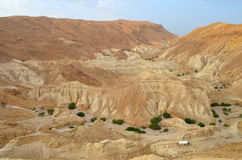 Beautiful landscape of rock formations and dunes. Along the Dead Sea coast, among sandy dunes.The landscape of the desert Royalty Free Stock Image