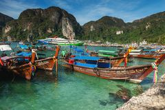 Beautiful landscape of rocks mountain and crystal clear sea with longtail boat Thailand. Summer, Travel, Vacation, Holiday concept. Summer, Travel, Vacation Royalty Free Stock Photography