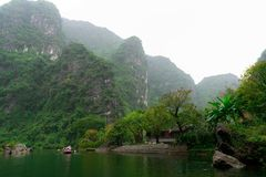 Beautiful landscape with rocks and rice fields in Ninh Binh and Tam Coc in Vietnam. stock photo