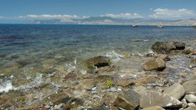 Beautiful landscape with rocks in transparent sea stock video footage