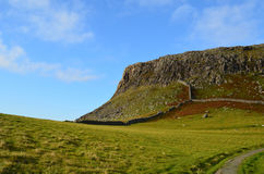 Beautiful Landscape with Rolling Hills and Sea Cliffs in Scotlan. Neist Point`s landscape with pastures, rolling hills and sea cliffs in Scotland Royalty Free Stock Photo